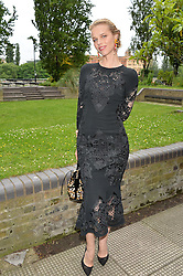 EVA HERZIGOVA at an Evening at The River Cafe in aid of the NSPCC held at The River Cafe, Thames Wharf, Rainville Road, London on 19th June 2016