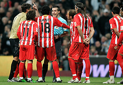 Almeria's players argue with the referee during La Liga match, November 05, 2009.