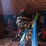 Mongolia. Ulaanbaatar. Mr Tserendolgor,  master shaman and Mrs Batzaya Otgonzaya the student shaman , during  a shamanic ceremony in a yurt  . Ulaan baatar
