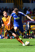 Dave Edwards tackles Daryl Murphy during the Sky Bet Championship match between Wolverhampton Wanderers and Ipswich Town at Molineux, Wolverhampton, England on 18 April 2015. Photo by Alan Franklin.