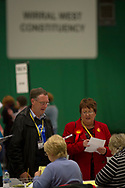 Party workers observing the verification of ballot papers at the count at Bidston Tennis Centre, Wirral for the Wirral West constituency in the 2015 UK General Election. The constituency was held by Esther McVey for the Conservative Party, who won the seat from Labour at the 2010 General Election. The constituency was one of the key marginal seats contested between the two main UK political parties.