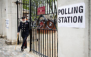 UNITED KINGDOM, London: 7 May 2015,  A Chelsea Pensioner leaves after voting at a polling station in Chelsea for the 2015 Election, London, England. Andrew Cowie / Story Picture Agency