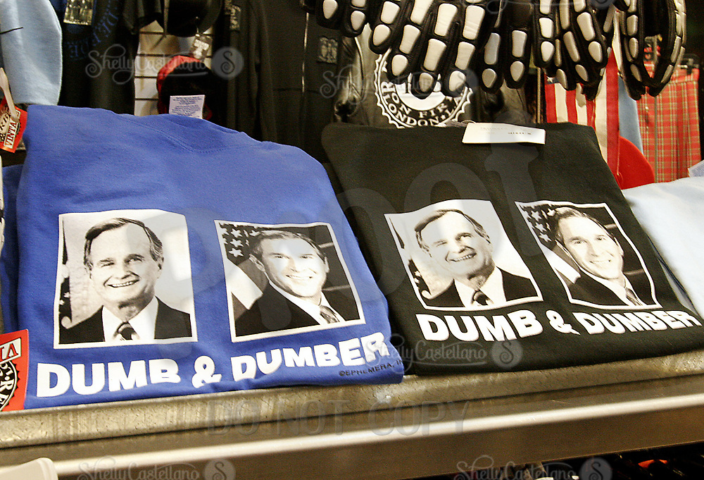Jan 15, 2005; Hollywood, CA, USA; T-shirts for sale inside a store located at the City Walk outside Universal Studios Theme Park in Hollywood. Photos on the shirts show faces of current President George Bush and his father the former United States President stating 'Dumb and Dumber'. Mandatory Credit: Photo by Shelly Castellano/ZUMA Press.