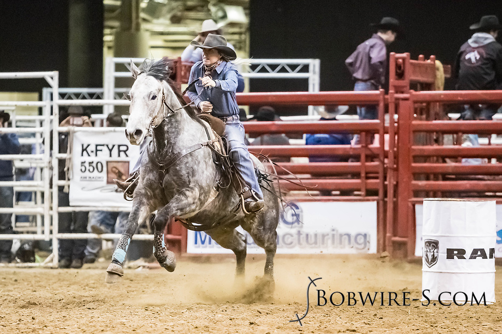 Whitney Entzel makes her barrel run at the Bismarck Rodeo on Friday, Feb. 2, 2018. She ran a 19.15.