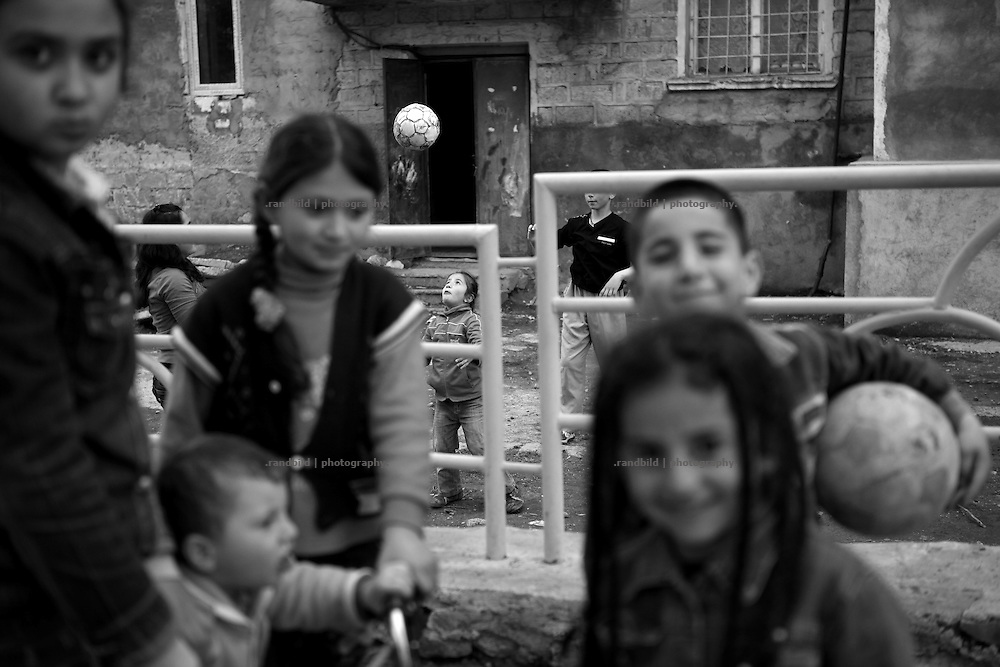 "Kids playing on a street. This image is part of the photoproject ""The Twentieth Spring"", a portrait of caucasian town Shushi 20 years after its so called ""Liberation"" by armenian fighters. In its more than two centuries old history Shushi was ruled by different powers like armeniens, persians, russian or aseris. In 1991 a fierce battle for Karabakhs independence from Azerbaijan began. During the breakdown of Sowjet Union armenians didn´t want to stay within the Republic of Azerbaijan anymore. 1992 armenians manage to takeover ""ancient armenian Shushi"" and pushed out remained aseris forces which had operate a rocket base there. Since then Shushi became an ""armenian town"" again. Today, 20 yeras after statement of Karabakhs independence Shushi tries to find it´s opportunities for it´s future. The less populated town is still affected by devastation and ruins by it´s violent history. Life is mostly a daily struggle for the inhabitants to get expenses covered, caused by a lack of jobs and almost no perspective for a sustainable economic development. Shushi depends on donations by diaspora armenians. On the other hand those donations have made it possible to rebuild a cultural centre, recover new asphalt roads and other infrastructure. 20 years after Shushis fall into armenian hands Babies get born and people won´t never be under aseris rule again. The bloody early 1990´s civil war has moved into the trenches of the frontline 20 kilometer away from Shushi where it stuck since 1994. The karabakh conflict is still not solved and could turn to an open war every day. Nonetheless life goes on on the south caucasian rocky tip above mountainious region of Karabakh where Shushi enthrones ever since centuries."