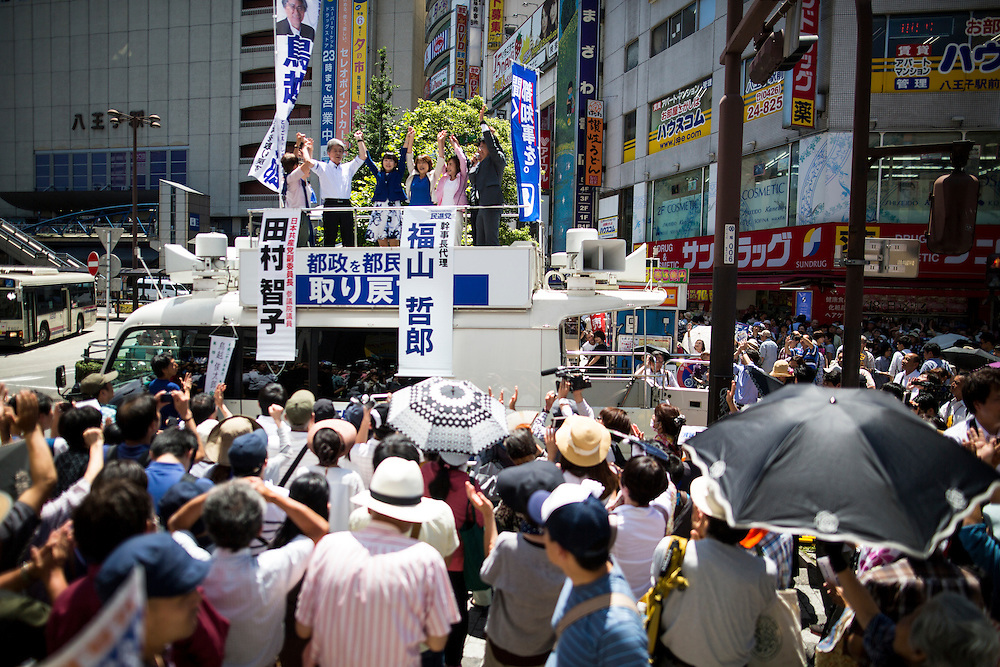 TOKYO, JAPAN - JULY 30 : Journalist Shuntaro Torigoe, a candidate for Tokyo governor and his team raised their hands together greeting people after the speech campaign during the last day of Tokyo Gubernatorial Election campaign rally at Hachiōji Station, Tokyo, Japan on Saturday, July 30, 2016. Tokyo residents will vote on July 31 for a new Governor of Tokyo who will deal with issues related to the hosting of the Tokyo Summer Olympics and Paralympics in 2020. (Photo: Richard Atrero de Guzman/NUR Photo)