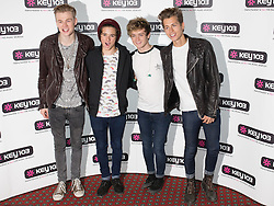 © Licensed to London News Pictures . 08/11/2013 . Manchester , UK . THE VAMPS . Stars in front of the Key 103 brand board at Manchester Town Hall ahead of performing on stage . The Christmas lights are turned on in Manchester this evening (Friday 8th November 2013) . Photo credit : Joel Goodman/LNP