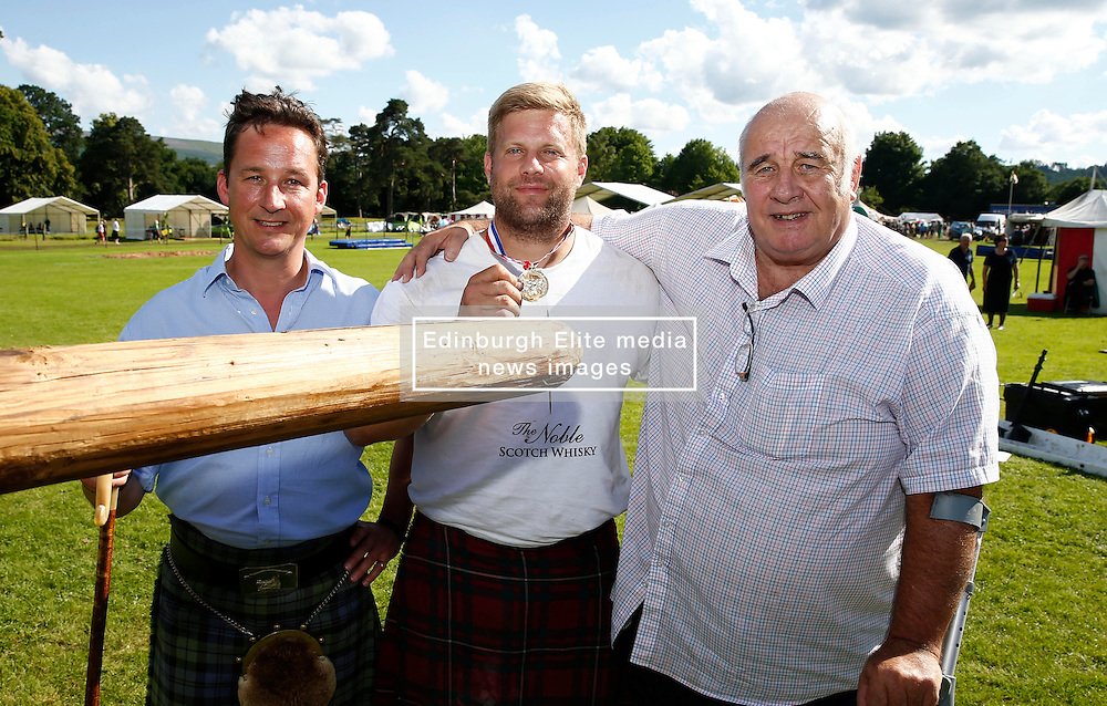 Inveraray Highland Games. Competitions include Piping, Highland Dancing, Heavy and Light events as well as the World Caber Tossing Championship.  Scott Rider is the 2016 World Caber Tossing Champion. Seen with Scott is His Grace The Duke of Argyll (Left) and Donald Clark sponsor of the event(c) Stephen Lawson | Edinburgh Elite media