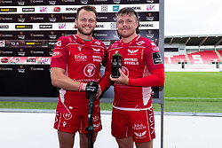 Guinness PRO14, Parc y Scarlets, Llanelli, UK 22/8/2020<br /> Scarlets v Cardiff Blues<br /> Steff Hughes of Scarlets presents Steff Evans of Scarlets with the Guinness PRO14 Player of the Match <br /> Mandatory Credit ©INPHO/Ryan Hiscott