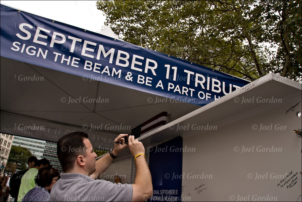 People adding their names to steel beams that will be used in the contruction of the National September 11 Memorial Museum on the 7th Anniversary of 9/11 at Battery Park in New York.