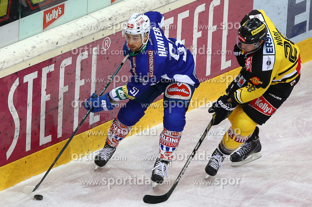 06.01.2015, Albert Schultz Eishalle, Wien, AUT, EBEL, UPC Vienna Capitals vs EC VSV, 36. Runde, im Bild Eric Hunter (EC VSV) und Andreas Noedl (UPC Vienna Capitals) // during the Erste Bank Icehockey League 36th Round match between UPC Vienna Capitals and EC VSV at the Albert Schultz Ice Arena, Vienna, Austria on 2015/01/06. EXPA Pictures © 2015, PhotoCredit: EXPA/ Thomas Haumer