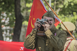 May 5, 2019 - Madrid, Madrid, Spain - A man seen taking pictures with a Russian zenit camera during the celebration..The Russian Hispano community in Madrid, Spain celebrated the victory of the Soviet Union in the Second World War at Prado Avenue. (Credit Image: © Alberto Sibaja/SOPA Images via ZUMA Wire)
