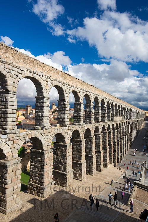 Famous spectacular Roman aqueduct, built of granite blocks, and Plaza del Azoguejo, Segovia, Spain