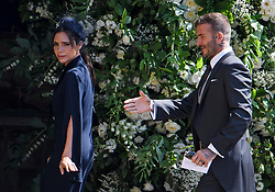 © Licensed to London News Pictures. FILE PICTURE 19/05/2018. London, UK. DAVID AND VICTORIA BECKHAM arrive at The wedding of Prince Harry, The Duke of Sussex to Meghan Markle, The Duchess of Sussex, at St George's Chapel in Windsor. Bookmakers have suspended bets on the celebrity coulee getting a divorce. Photo credit: Ben Cawthra/LNP