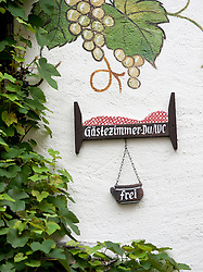 Sign outside guesthouse  in Beilstein village on River Mosel in Rhineland-Palatinate Germany