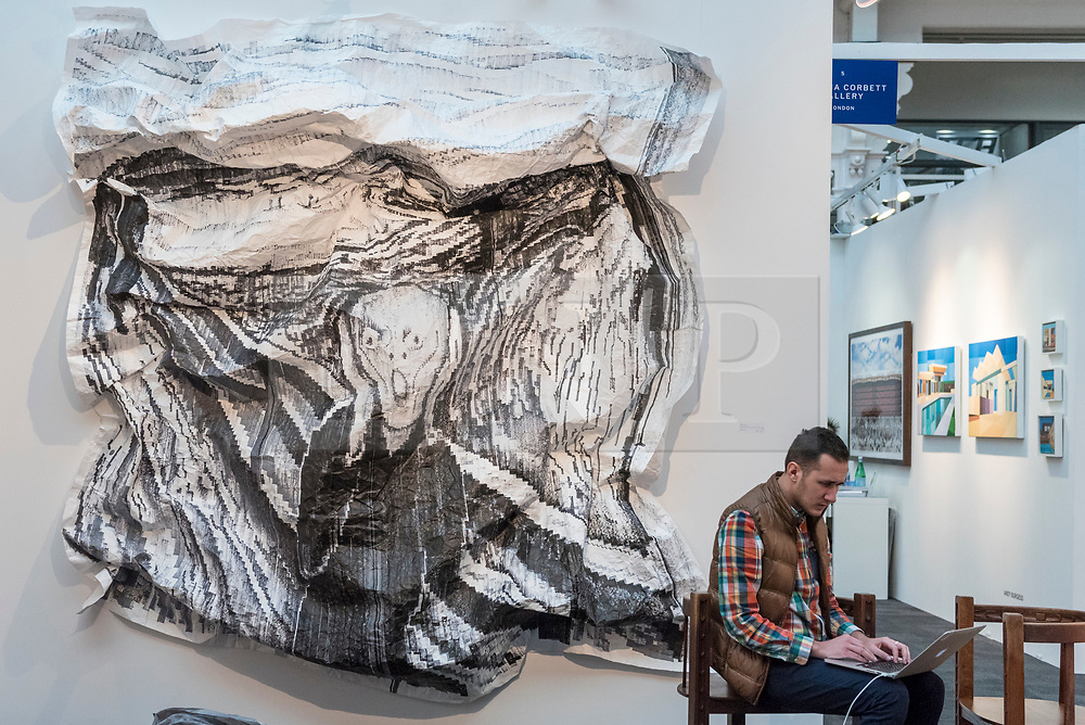 © Licensed to London News Pictures. 16/01/2018. LONDON, UK.  Preview day of the 30th anniversary of the London Art Fair.  The fair launches the international art calendar with modern and contemporary art from leading galleries around the world and is taking place at the Business Design Centre, Islington from 17 to 21 January 2018.   Photo credit: Stephen Chung/LNP