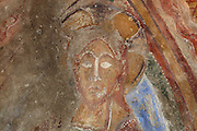 Detail of the face of the Christ in Majesty shown within a mandorla, 12th century frescoes in the choir of the Pre-Romanesque Chapel of Saint Martin de Fenollar (Sant Marti de Fenollar), 9th century, Maureillas Les Illas, Pyrenees Orientales, France. The frescoes are an outstanding piece of work, which greatly impressed modern artists, especially Pablo Picasso and Georges Braque in 1910. Picture by Manuel Cohen