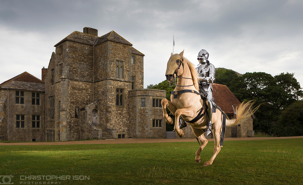21st century knight, Arne Koets, gives his Lusitano stallion, Sultan a leg stretch after travelling from Holland to compete in Carisbrooke Castle's annual jousting tournament which starts tomorrow on the Isle of Wight and runs for six days over the next two weeks.<br /> Picture date Monday 17th August, 2015.<br /> Picture by Christopher Ison for English Heritage.<br /> PR enquiries Isobel Uden, English Heritage PR Manager South East - 07778926960<br /> Contact photographer +447544 044177 chris@christopherison.com