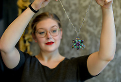 Pictured: Jaine Heggie from Bonham's auctioneers with one of the highlights of the sale, an arts and crafts necklace from the 1920's.<br /> <br /> © Dave Johnston / EEm