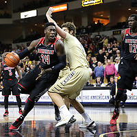 Louisville Cardinals forward Montrezl Harrell (24) drives to the basket against UCF Knights forward Dylan Karell (15) during an  NCAA basketball game between the 14th ranked Louisville Cardinals and the UCF Knights at the CFE Arena on Tuesday, December 31, 2013 in Orlando, Florida. (AP Photo/Alex Menendez)