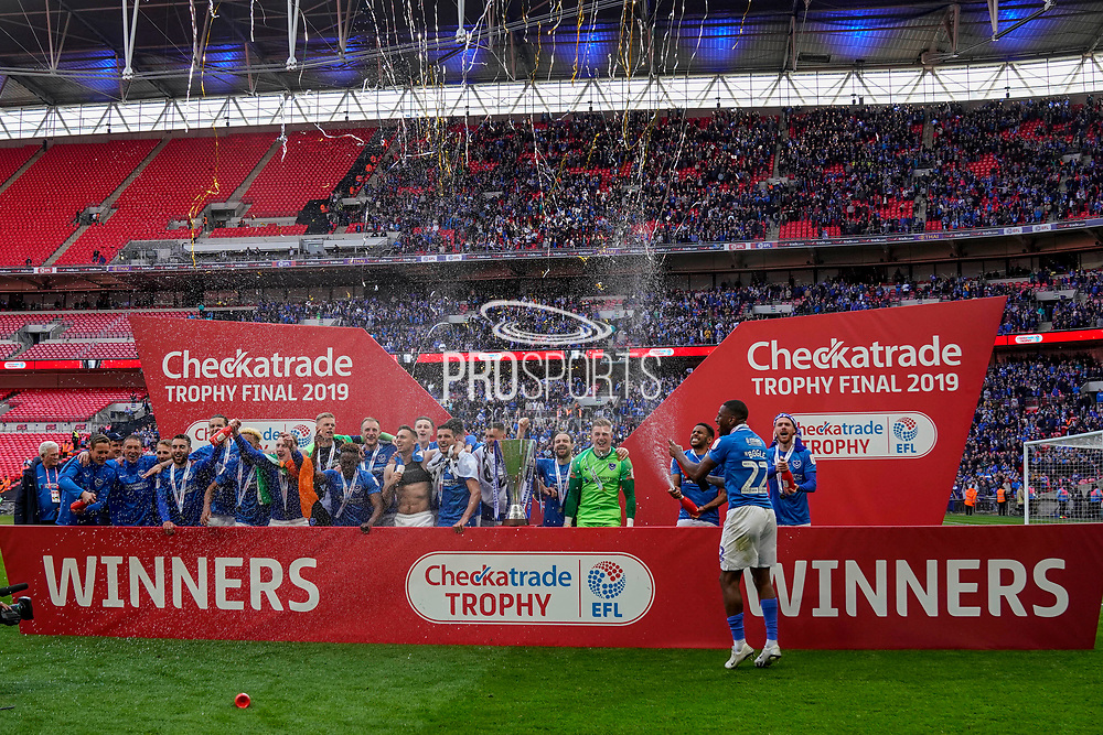 Portsmouth celebrate winning the Checkatrade EFL Trophy, 5-4 on penalties during the EFL Trophy Final match between Portsmouth and Sunderland at Wembley Stadium, London, England on 31 March 2019.