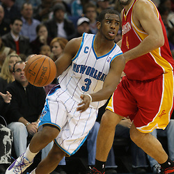 Jan 02, 2010; New Orleans, LA, USA; New Orleans Hornets guard Chris Paul (3) drives past Houston Rockets forward Luis Scola (4) during the third quarter at the New Orleans Arena. Mandatory Credit: Derick E. Hingle-US PRESSWIRE