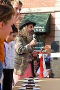 "September 25, 2010 - The inventor of Fluff Archibald Querey, portrayed by Michael Katz, instructs contestants in a Whoppie Pie eating contest at the 5th Fluff Fest this past Saturday in Somerville. Michael is a professor of theater at MIT and has been portraying Archibald Query at Fluff Fest for the past 5 years. He said he loved Fluff because, ""It sticks to everything."" Photo by Lathan Goumas."