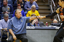 Jan 12, 2019; Morgantown, WV, USA; West Virginia Mountaineers head coach Bob Huggins fist bumps Oklahoma State Cowboys guard Lindy Waters III (21) prior to their game at WVU Coliseum. Mandatory Credit: Ben Queen-USA TODAY Sports