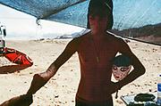 Man with dog and mask at Middle East Tek, Wadi Rum, Jordan, 2008