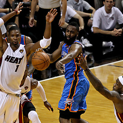 Jun 19, 2012; Miami, FL, USA; Oklahoma City Thunder guard James Harden (13) passes the ball as Miami Heat power forward Chris Bosh (1) and small forward LeBron James (6) defend during the second quarter in game four in the 2012 NBA Finals at the American Airlines Arena. Mandatory Credit: Derick E. Hingle-US PRESSWIRE