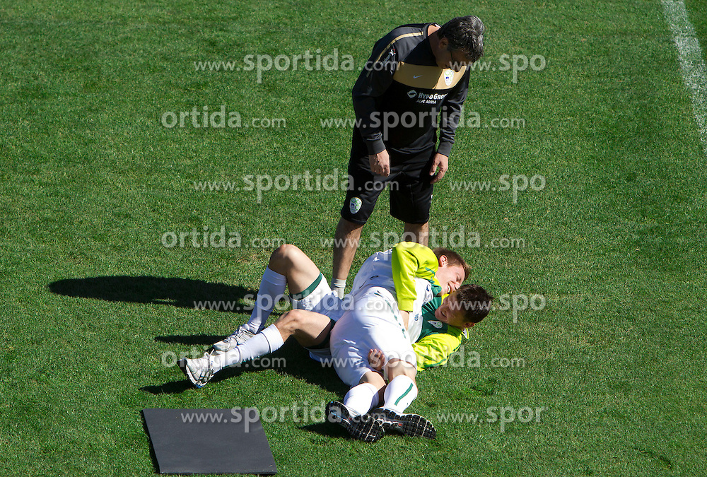 Khalid Nasif watching Valter Birsa of Slovenia and Andraz Kirm of Slovenia fighting for fun during a training session at  Hyde Park High School Stadium on June 14, 2010 in Johannesburg, South Africa.  (Photo by Vid Ponikvar / Sportida)