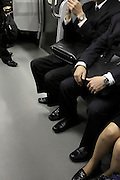 Japan business people male and female during their train commuting