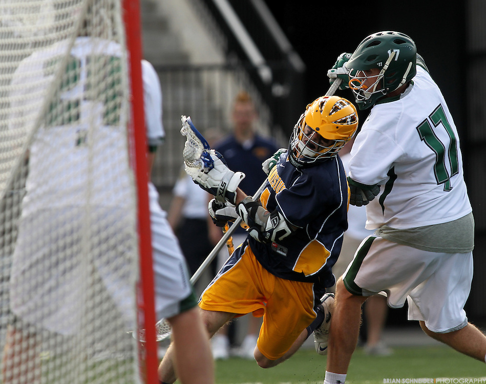 May 12, 2012; Baltimore, MD, USA; Canisius College Golden Griffins attack Jimmy Haney (4) scores against Loyola Maryland Greyhounds at Ridley Athletic Complex in Baltimore, MD. Mandatory Credit: Brian Schneider-www.ebrianschneider.com
