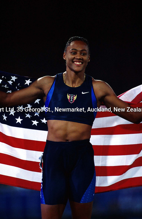 Marion Jones of the United States celebrates winning gold in the womens 200m final at the Olympics, Sydney, Australia, 28 September 2000.  PHOTO: PHOTOSPORT
