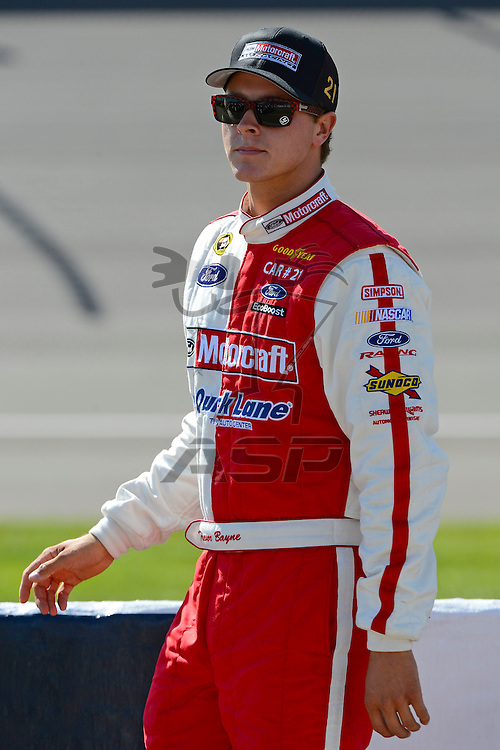 Brooklyn, MI  - Aug 17, 2012: Trevor Bayne (21) stands on pit row during qualifying for the Pure Michigan 400 at Michigan International Speedway in Brooklyn, MI.