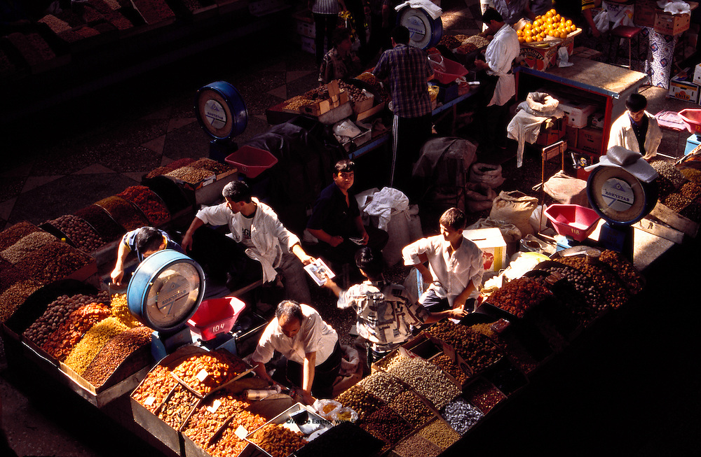 Vendors of nuts, apricots, raisins and other dried fruits gateher in one area of the Zelyony bazaar in Almaty.  This market, on the route of the old silk road, is awash with colors, aromas and sounds.  Separate areas house vendors selling vegetables, honey, fruit, flowers, meat and fish, herbs and spices and dairy products.