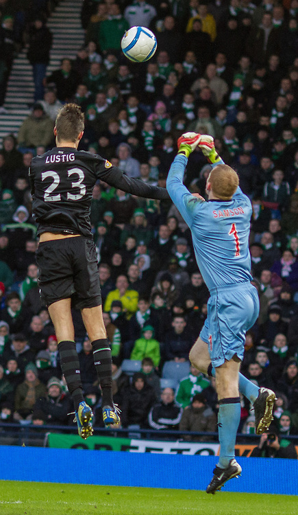 mikael lustig challenges craig samson for the ball