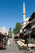 Mosque with minaret dominates view through inner city. Sarajevo. Bosnia. Eastern Europe.