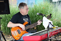 11 July 2015:  Three members including Chris Briggs (pictured) and Marc Boone of the group Marc Boon and the Unknown Legends perform for the festival comers at the 2015 Sugar Creek Arts Festival in Uptown Normal Illinois