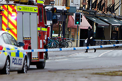 "© Licensed to London News Pictures.  13/02/2014. OXFORD, UK. A bomb disposal officer enters the building after a suspect package was received at the Army recruitment office in St Giles, Oxford. The package was one of seven received across the country in the last two days and has been described as ""crude but potentially viable with hallmarks of Northern Ireland-related terrorism. Photo credit: Cliff Hide/LNP"