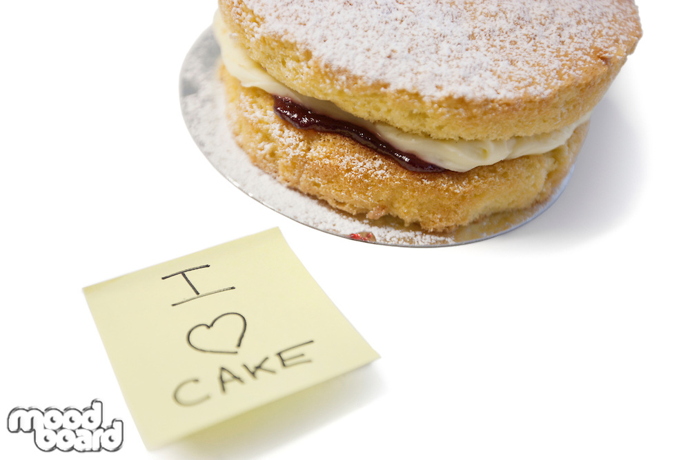 Cake slice with 'I love cake' sign on sticky notepaper