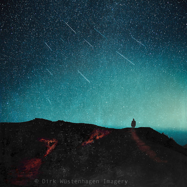 Man on a üath beneath a starry night sky - manipulated photograph