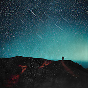 Man on a üath beneath a starry night sky - manipulated photograph