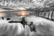 Storm damaged pier on the Albemarle Sound photographed at sunset. I took three images at different exposures and combined them in Photoshop to see details in the shadows and the sunset.