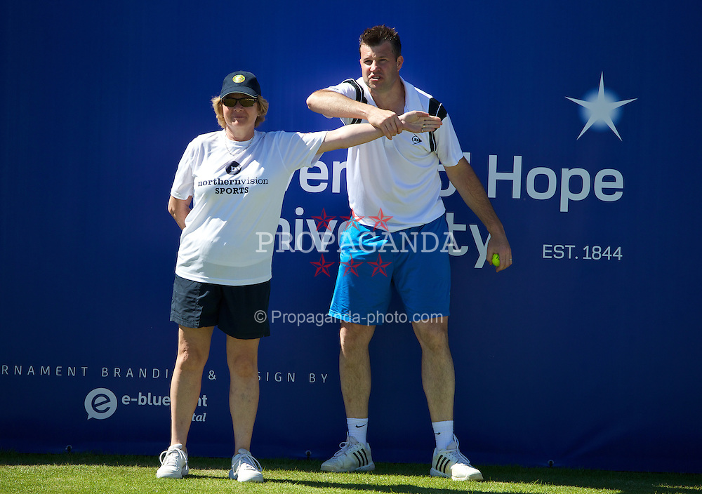 LIVERPOOL, ENGLAND - Friday, June 20, 2014: Barry Cowan and a line judge during Day Two of the Liverpool Hope University International Tennis Tournament at Liverpool Cricket Club. (Pic by David Rawcliffe/Propaganda)