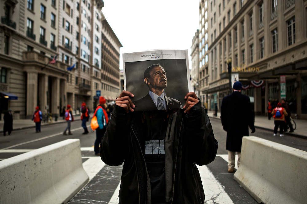 Jake Proctor, 22, stands for a portrait as he sells commemorative newspapers on the street before the inauguration parade for Pres. Barack Obama on January 21, 2013 in Washington, D.C.
