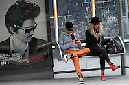 Israelis sit in bus station wearing sunglasses in Tel Aviv. February 27, 2014.  Photo by Oren Nahshon