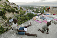 The shanty towns crawl up the sides of the mountain from Carrefour down below.  The scenery changes as you head farther up the mountain with the population becoming more hidden in the foliage in the mountain.
