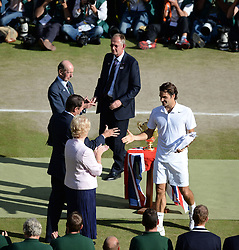 © Licensed to London News Pictures. 6th July 2014. London. UK. Federer with runner's up trophy. Crowds and celebrities watch the The Men's Final between Roger Federer, SUI v Novak Djokovic, SER at the Wimbledon Tennis Championships 2014. Photo credit : Mike King/LNP