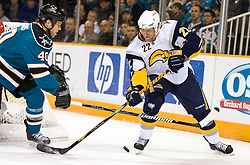 January 23, 2010; San Jose, CA, USA; Buffalo Sabres center Adam Mair (22) is defended by San Jose Sharks defenseman Kent Huskins (40) during the first period at HP Pavilion. San Jose defeated Buffalo 5-2. Mandatory Credit: Jason O. Watson / US PRESSWIRE